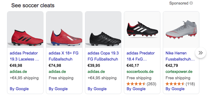 red, black, and grey adidas soccer cleats in google shopping ads