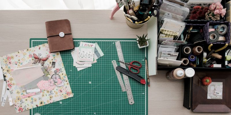 work desk with craft things on it